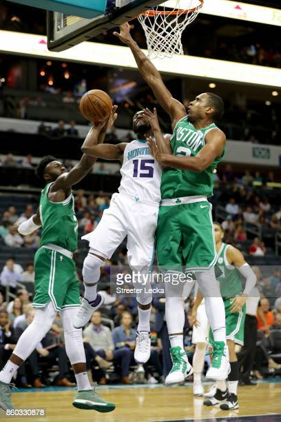 Kemba Walker of the Charlotte Hornets drives to the basket against Al Horford of the Boston Celtics during their game at Spectrum Center on October...