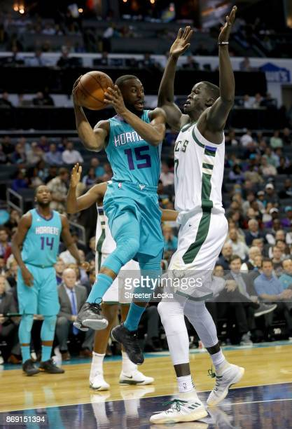 Kemba Walker of the Charlotte Hornets drives to the basket against Thon Maker of the Milwaukee Bucks during their game at Spectrum Center on November...