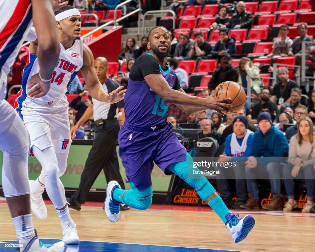 Kemba Walker #15 of the Charlotte Hornets drives to the basket next to Tobias Harris #34 of the Detroit Pistons during the an NBA game at Little Caesars Arena on January 15, 2018 in Detroit, Michigan.