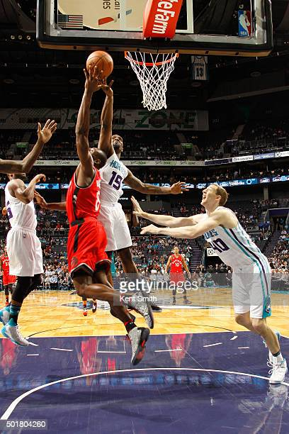 Kemba Walker of the Charlotte Hornets grabs the rebound against the Toronto Raptors on December 17 2015 at Time Warner Cable Arena in Charlotte North...