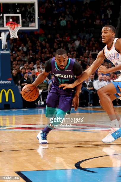 Kemba Walker of the Charlotte Hornets handles the ball during the game against the Oklahoma City Thunder on December 11 2017 at Chesapeake Energy...