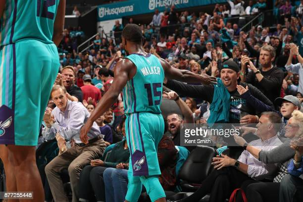 Kemba Walker of the Charlotte Hornets high fives fans during the game against the Atlanta Hawks on October 20 2017 at Spectrum Center in Charlotte...