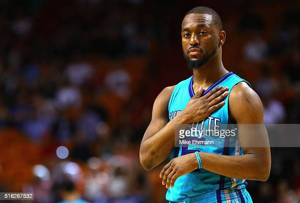 Kemba Walker of the Charlotte Hornets looks on during a game against the Miami Heat at American Airlines Arena on March 17 2016 in Miami Florida NOTE...