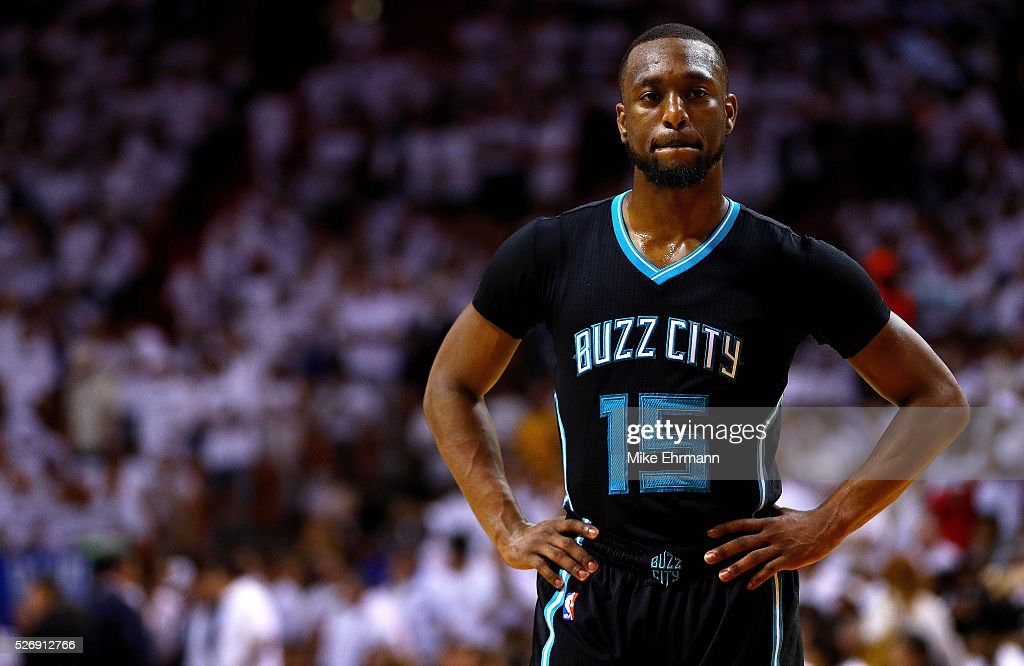 Kemba Walker #15 of the Charlotte Hornets looks on during Game Seven of the Eastern Conference Quarterfinals of the 2016 NBA Playoffs against the Miami Heat at American Airlines Arena on May 1, 2016 in Miami, Florida.