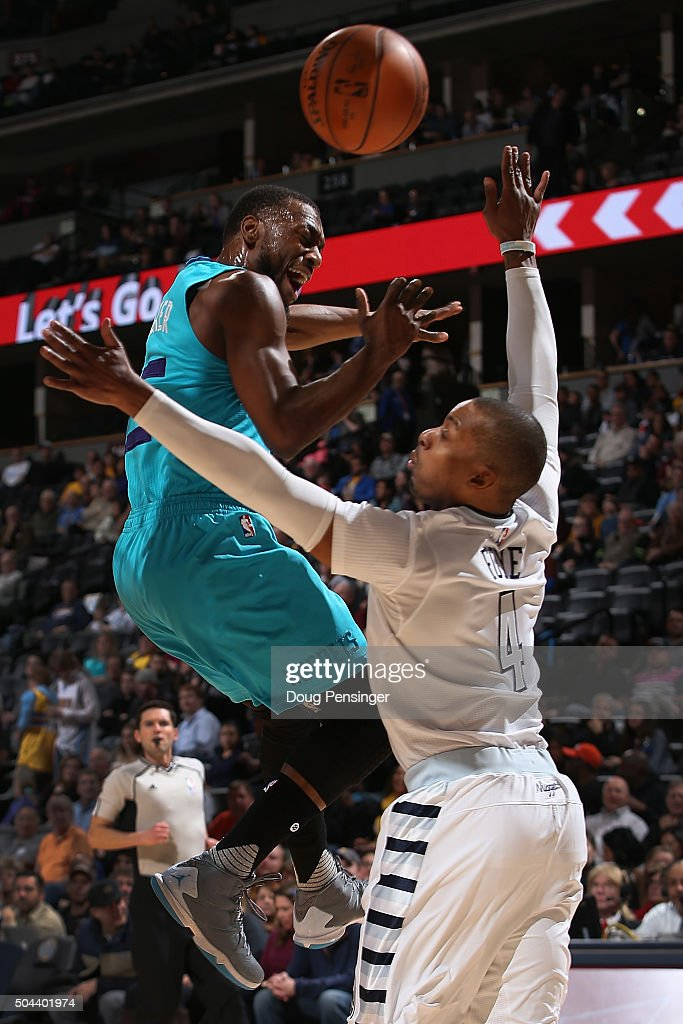 <a gi-track='captionPersonalityLinkClicked' href=/galleries/search?phrase=Kemba+Walker&family=editorial&specificpeople=5042442 ng-click='$event.stopPropagation()'>Kemba Walker</a> #15 of the Charlotte Hornets looses control of the ball against <a gi-track='captionPersonalityLinkClicked' href=/galleries/search?phrase=Randy+Foye&family=editorial&specificpeople=240185 ng-click='$event.stopPropagation()'>Randy Foye</a> #4 of the Denver Nuggets at Pepsi Center on January 10, 2016 in Denver, Colorado.