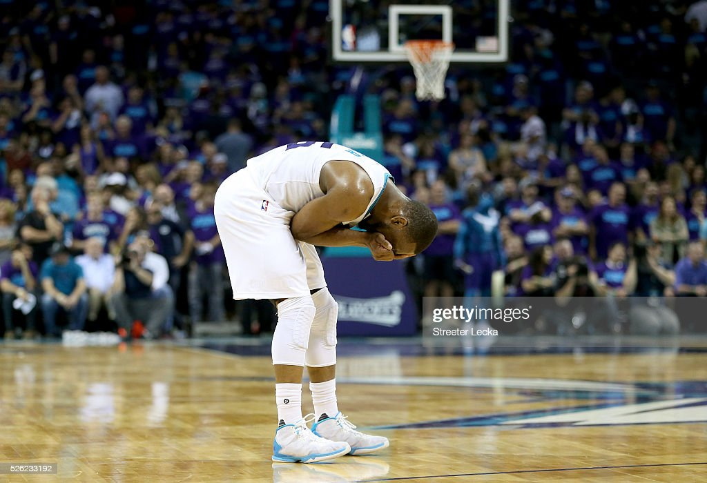 Kemba Walker #15 of the Charlotte Hornets reacts after a call against the Miami Heat during game six of the Eastern Conference Quarterfinals of the 2016 NBA Playoffs at Time Warner Cable Arena on April 29, 2016 in Charlotte, North Carolina.