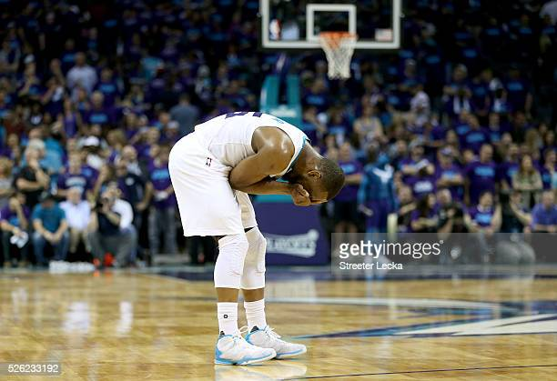 Kemba Walker of the Charlotte Hornets reacts after a call against the Miami Heat during game six of the Eastern Conference Quarterfinals of the 2016...