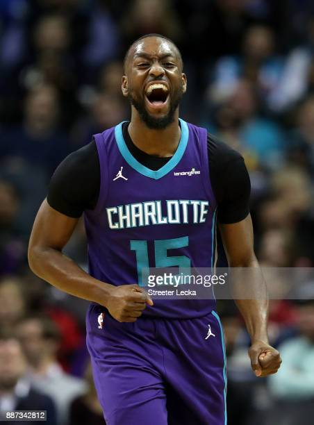 Kemba Walker of the Charlotte Hornets reacts after a play against the Golden State Warriors during their game at Spectrum Center on December 6 2017...