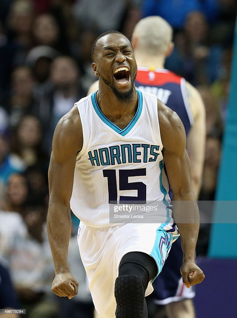 <a gi-track='captionPersonalityLinkClicked' href=/galleries/search?phrase=Kemba+Walker&family=editorial&specificpeople=5042442 ng-click='$event.stopPropagation()'>Kemba Walker</a> #15 of the Charlotte Hornets reacts after a play during their game against the Washington Wizards at Time Warner Cable Arena on November 25, 2015 in Charlotte, North Carolina. NBA -