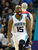 Kemba Walker of the Charlotte Hornets reacts after a play during their game against the Washington Wizards at Time Warner Cable Arena on November 25...