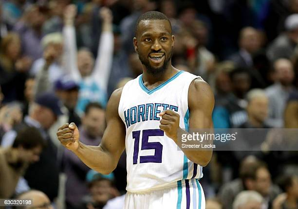 Kemba Walker of the Charlotte Hornets reacts after defeating the Los Angeles Lakers 117113 during their game at Spectrum Center on December 20 2016...