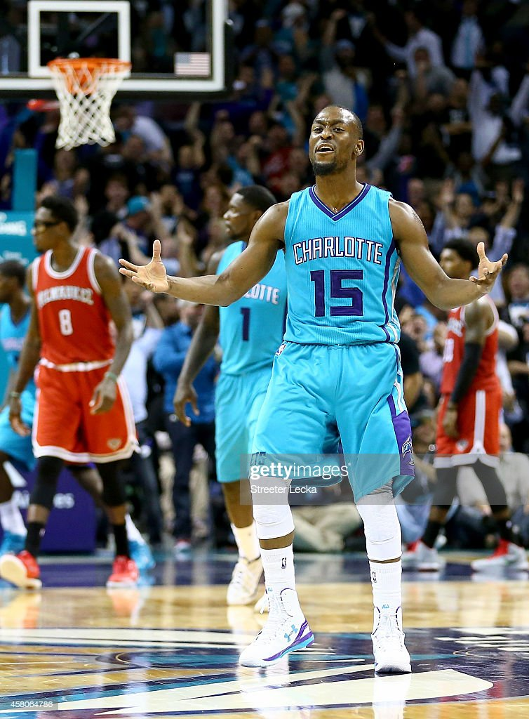 Kemba Walker #15 of the Charlotte Hornets reacts after hitting a game tieing shot late in the fourth quarter against the Milwaukee Bucks during their game at Time Warner Cable Arena on October 29, 2014 in Charlotte, North Carolina. The Charlotte Hornets defeated the Milwaukee Bucks 108-106 in overtime.