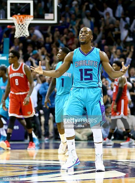 Kemba Walker of the Charlotte Hornets reacts after hitting a game tieing shot late in the fourth quarter against the Milwaukee Bucks during their...