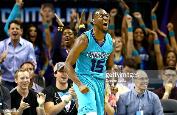 Kemba Walker of the Charlotte Hornets reacts after making a shot against the Milwaukee Bucks during their game at Time Warner Cable Arena on October...