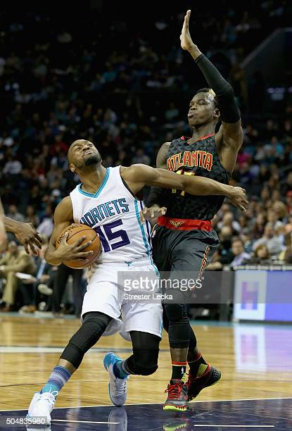 Kemba Walker of the Charlotte Hornets runs into Dennis Schroder of the Atlanta Hawks during their game at Time Warner Cable Arena on January 13 2016...