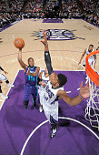 Kemba Walker of the Charlotte Hornets shoots against Jason Thompson of the Sacramento Kings on March 20 2015 at Sleep Train Arena in Sacramento...