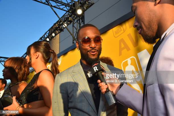 Kemba Walker of the Charlotte Hornets speaks to the media on the red carpet during the 2017 NBA Awards Show on June 26 2017 at Basketball City in New...