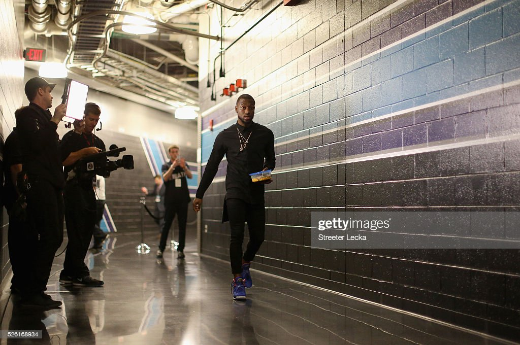 Kemba Walker #15 of the Charlotte Hornets walks to the locker room prior to the start of their game against the Miami Heat in game six of the Eastern Conference Quarterfinals of the 2016 NBA Playoffs at Time Warner Cable Arena on April 29, 2016 in Charlotte, North Carolina.
