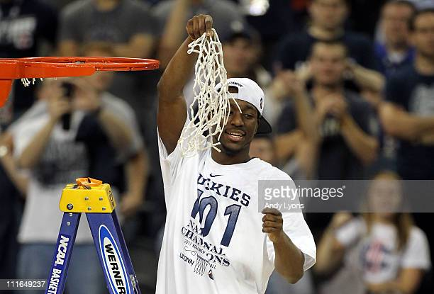 Kemba Walker of the Connecticut Huskies cuts down the net after defeating the Butler Bulldogs to win the National Championship Game of the 2011 NCAA...
