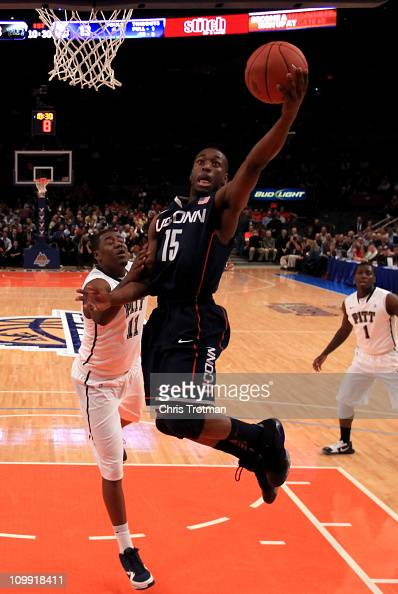 Kemba Walker of the Connecticut Huskies drives to the basket against Dante Taylor of the Pittsburgh Panthers during the quarterfinals of the 2011 Big...