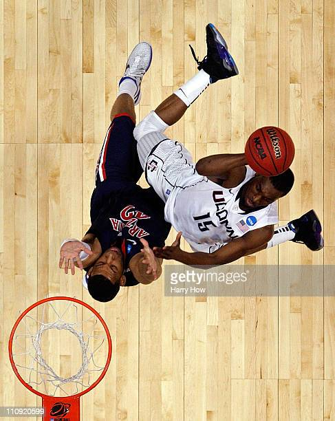 Kemba Walker of the Connecticut Huskies goes to the basket against Jamelle Horne of the Arizona Wildcats during the west regional final of the 2011...