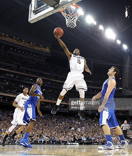 Kemba Walker of the Connecticut Huskies goes to the hoop past Josh Harrellson and Doron Lamb of the Kentucky Wildcats during the National Semifinal...