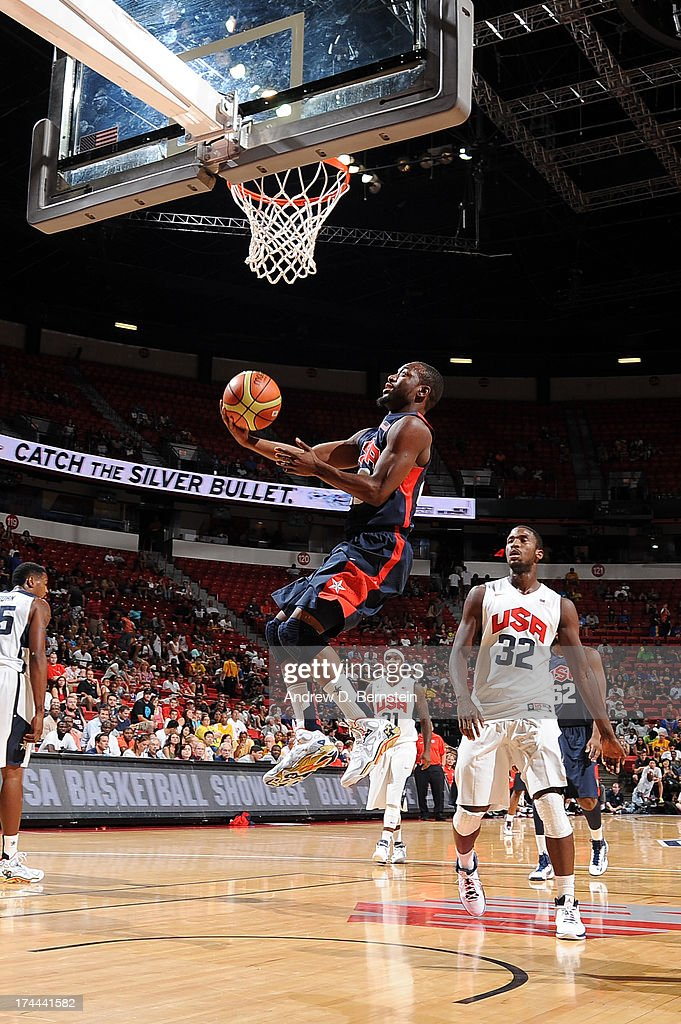 Kemba Walker #26 of the USA Blue Team attempts a shot during the 2013 USA Basketball Showcase at the Thomas and Mack Center on July 25, 2013 in Las Vegas, Nevada.