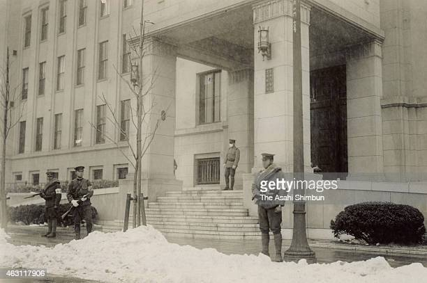 Kempeitai military police stand guard at their headquarters during the February 26 Incident on February 26 1936 in Tokyo Japan