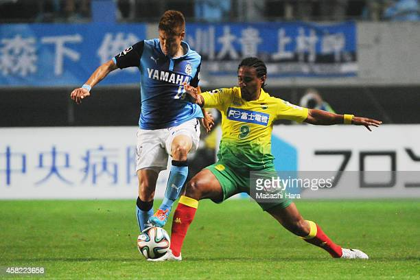 Kempes of JEF United Chiba and Masahiko Inoha of Jubilo Iwata compete for the ball during the JLeague second division match between JEF United Chiba...