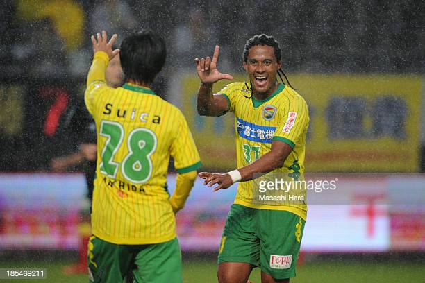 Kempes whose real name is Everton Kempes dos Santos Goncalves of JEF United Chiba celebrates scoring his team's second goal with his team mate Yamato...
