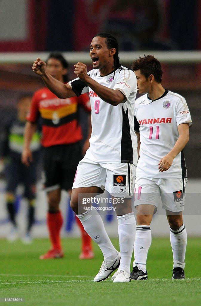 Kempes whose real name is Everton Kempes dos Santos Goncalves of Cerezo Osaka celebrates scoring the first goal during the JLeague match between...