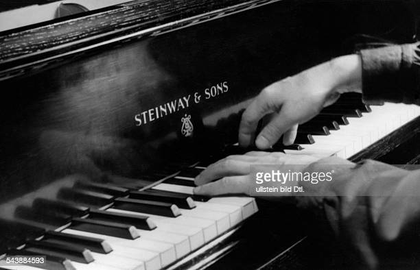 Kempff Wilhelm Pianist composer Germany*25111895The hands of the pianist playing a piano by Steinway Sons Photographer Charlotte Willott 1953Vintage...