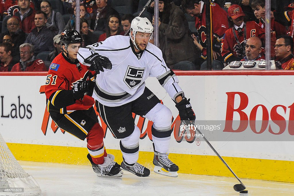 Ken Agostino #51 of the Calgary Flames chases <a gi-track='captionPersonalityLinkClicked' href=/galleries/search?phrase=Jake+Muzzin&family=editorial&specificpeople=7205557 ng-click='$event.stopPropagation()'>Jake Muzzin</a> #6 of the Los Angeles Kings during an NHL game at Scotiabank Saddledome on April 9, 2014 in Calgary, Alberta, Canada. The Flames defeated the Kings 4-3 in shootout.
