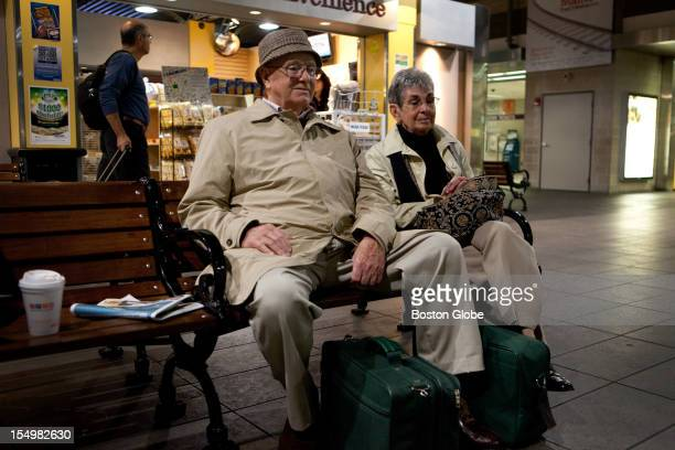 Ken and Priscilla Wheeler of Shirley Mass wait in Boston's North Station for the MBTA commuter train back to Shirley after their flight to Bermuda...