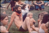 Ken Babbs one of the Merry Pranksters in the Free Stage audience watching the puppet show at the Woodstock music festival August 1969