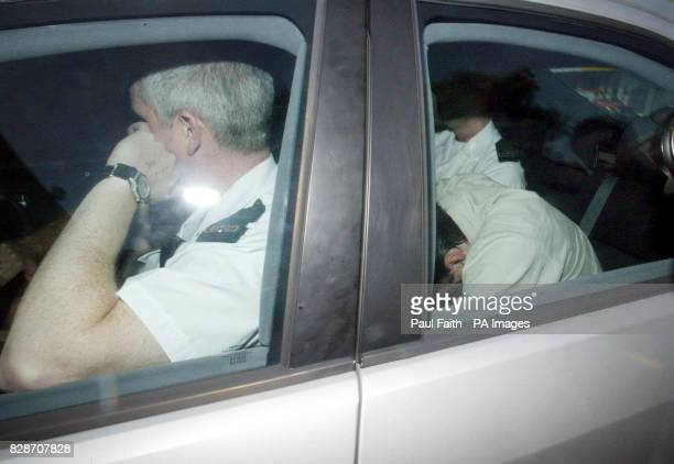 Ken Barrett hides in the back of a police car as he arrives at Belfast Magistrates court where he denied murdering Belfast lawyer Pat Finucane who...