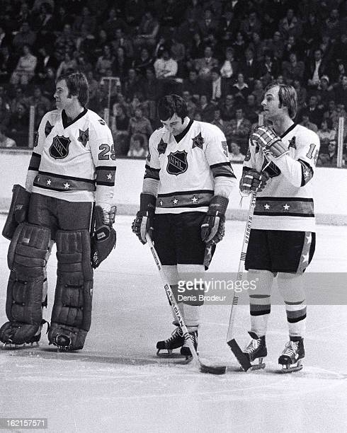 Ken Dryden Guy Lapointe and Guy LaFleur of the Wales Conference look on during the NHL AllStar Game on January 21 1975 in Montreal Quebec Canada