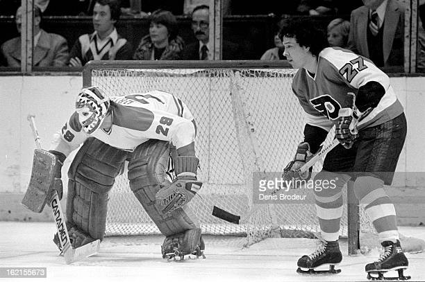 Ken Dryden of the Montreal Canadiens guards the net during against Reggie Leach of the Philadelphia Flyers circa 1976 in Montreal Quebec Canada