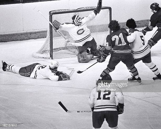 Ken Dryden of the Montreal Canadiens makes a glove save against the Buffalo Sabres at the Montreal Forum circa 1976 in Montreal Quebec Canada