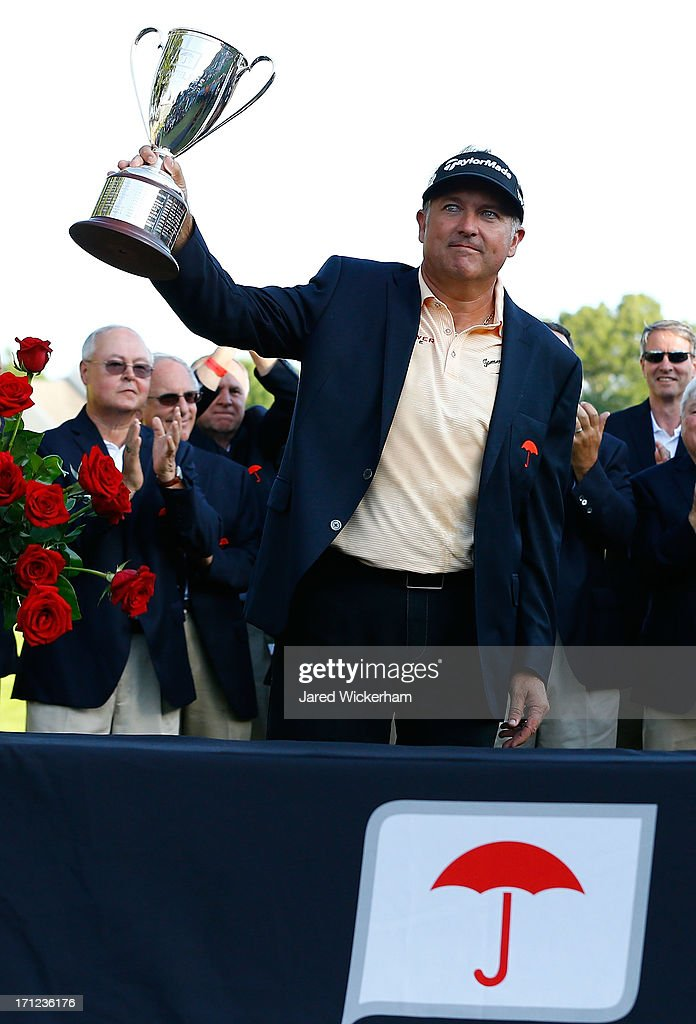 Ken Duke holds up the Traveler's Championship trophy after winning in a second playoff against Chris Stroud during the final round of the 2013 Travelers Championship at TPC River Highlands on June 23, 2012 in Cromwell, Connecticut.