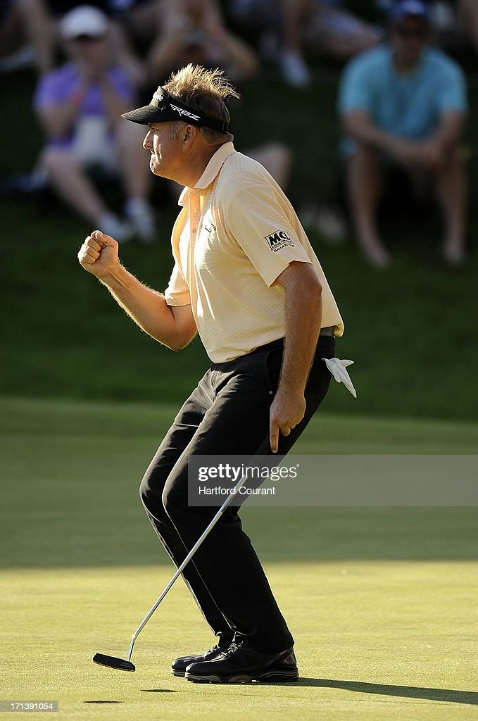 Ken Duke pumps his fist after sinking his winning putt from 2' 9' on the 18th green during the second playoff hole with Chris Stroud in the Travelers Championship at the TPC River Highlands in Cromwell, Connecticut, Sunday, June 23, 2013.