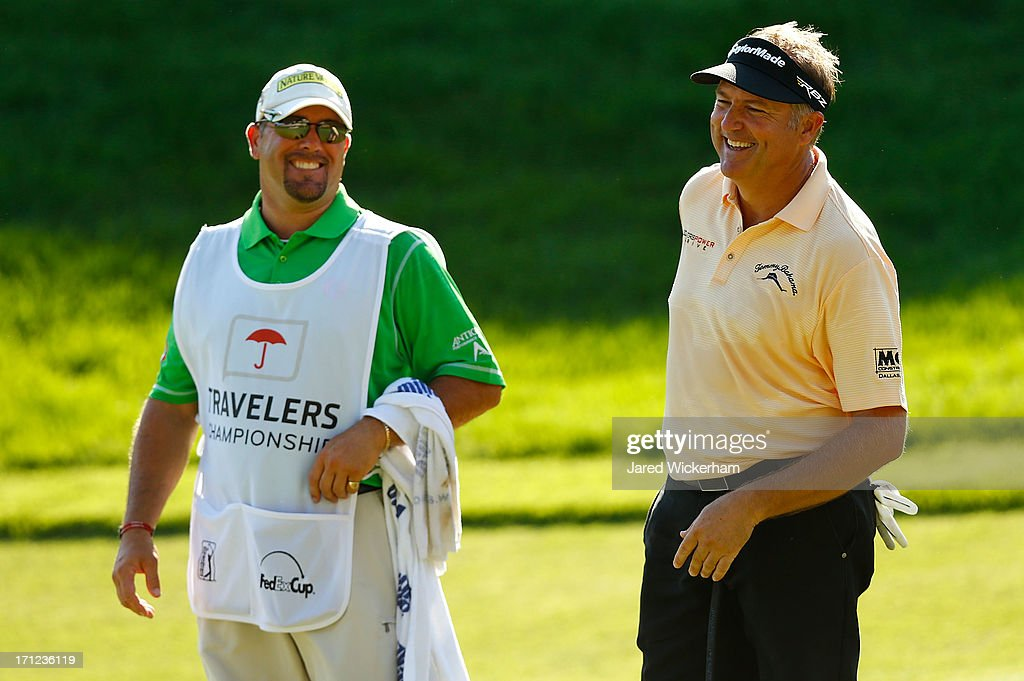<a gi-track='captionPersonalityLinkClicked' href=/galleries/search?phrase=Ken+Duke&family=editorial&specificpeople=2551619 ng-click='$event.stopPropagation()'>Ken Duke</a> shares a laugh with his caddy on the 18th green during the final round of the 2013 Travelers Championship at TPC River Highlands on June 23, 2012 in Cromwell, Connecticut.