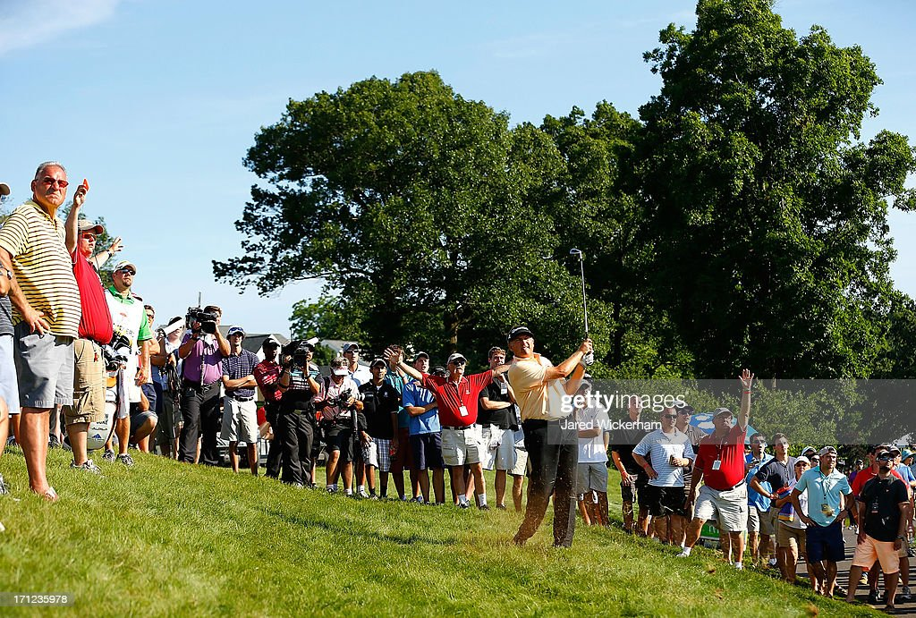 Ken Duke takes his second shot from above the cart path on the 18th hole during the final round of the 2013 Travelers Championship at TPC River Highlands on June 23, 2012 in Cromwell, Connecticut.