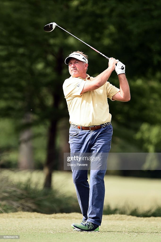 Ken Duke watches his tee shot on the seventh hole during a continuation of the first round of the Zurich Classic at TPC Louisiana on April 29, 2016 in Avondale, Louisiana.