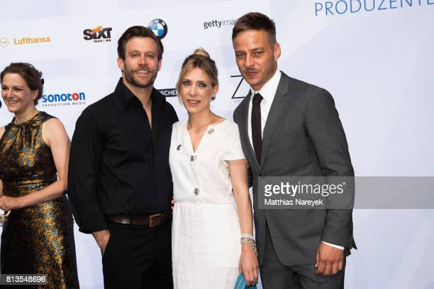 Ken Duken his wife Marisa Leonie Bach and Tom Wlaschiha attend the Summer Party of the German Producers Alliance on July 12 2017 in Berlin Germany