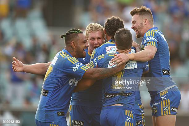 Ken Edwards Daniel Alvaro Brad Takairangi Michael Gordon and Clint Gutherson of the Eels celebrate Brad Takairangi scoring a try during the round six...