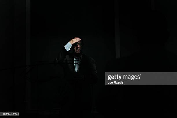 Ken Feinberg Administrator of the Independent Claims Facility for BP's $20 billion escrow fund shields his eyes from the sun as he listens to a...