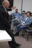 Ken Flores center alone with his parents Luis and Eloisa attend a meeting with Rep Steve Pearce RNM at Luna Community College in Santa Rosa NM