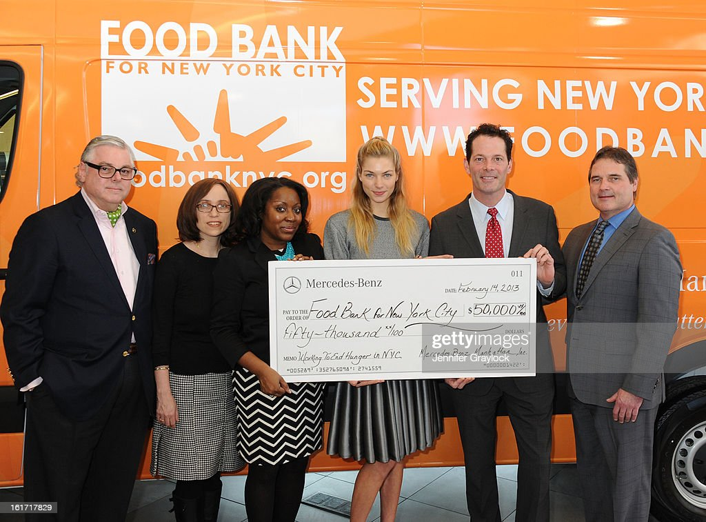 Ken Fox, CDO Food Bank for New York City Alyssa Herman, CEO and President Food Bank for New York City Margarette Purvis, Model Jessica Hart, General Manager Mercedes-Benz Manhattan Blair Creed and General Sales Manager Mercedes-Benz ManhattanTom Shanley unveils the Food Bank For New York City's Sprinter Van Donated By Mercedes-Benz Manhattan at the Mercedes-Benz 11th avenue on February 14, 2013 in New York City.