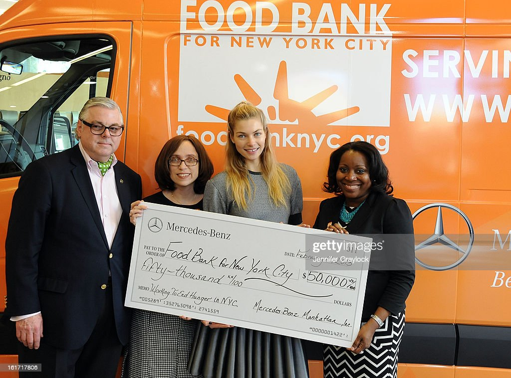 Ken Fox, CDO Food Bank for New York City Alyssa Herman, Model Jessica Hart and CEO and President Food Bank for New York City Margarette Purvis unveils the Food Bank For New York City's Sprinter Van Donated By Mercedes-Benz Manhattan at the Mercedes-Benz 11th avenue on February 14, 2013 in New York City.